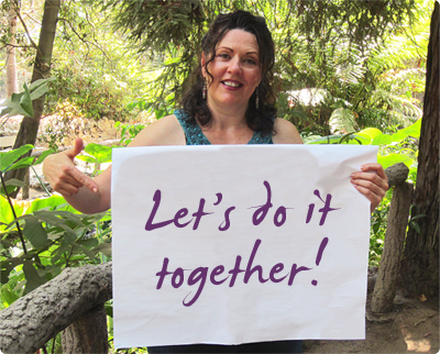 Jennifer with sign that says Let's Do It Together